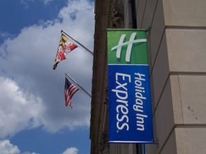 Flag Signs hanging exterior storefront 3 300x225